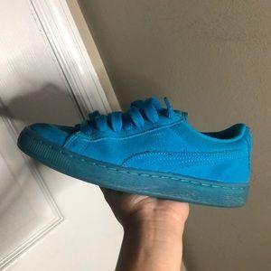 Blue suede pumas
